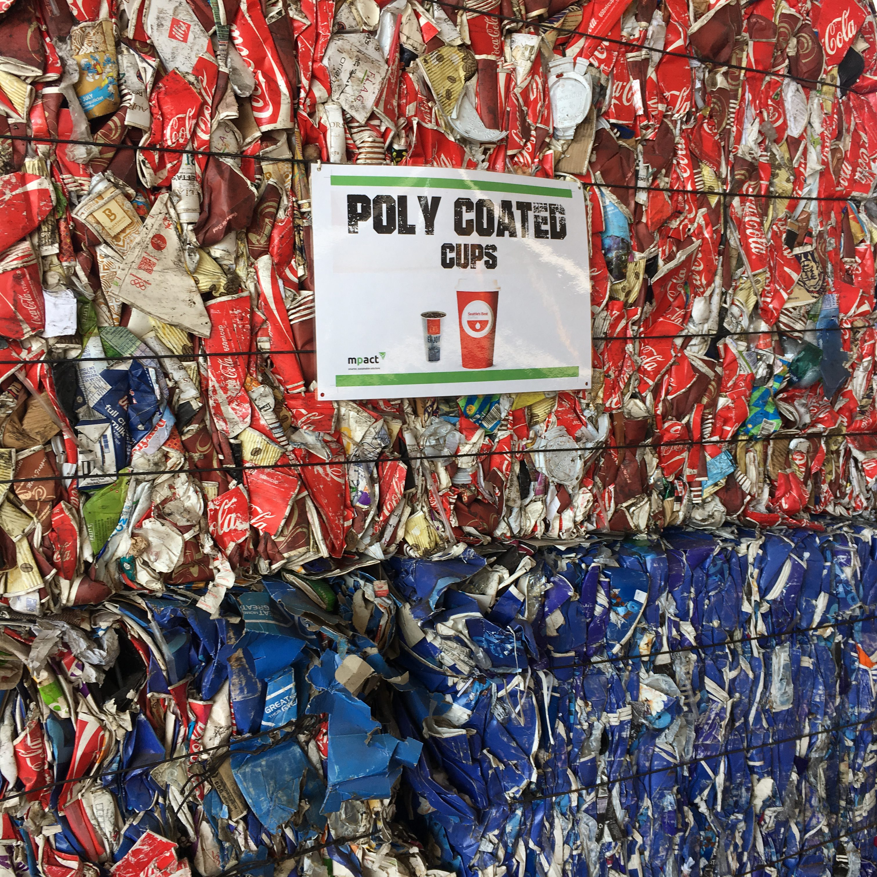Bales of paper cups and popcorn buckets awaiting their turn to be recycled.