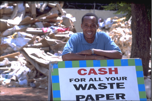 black man with cash for paper board and recycle backgroud