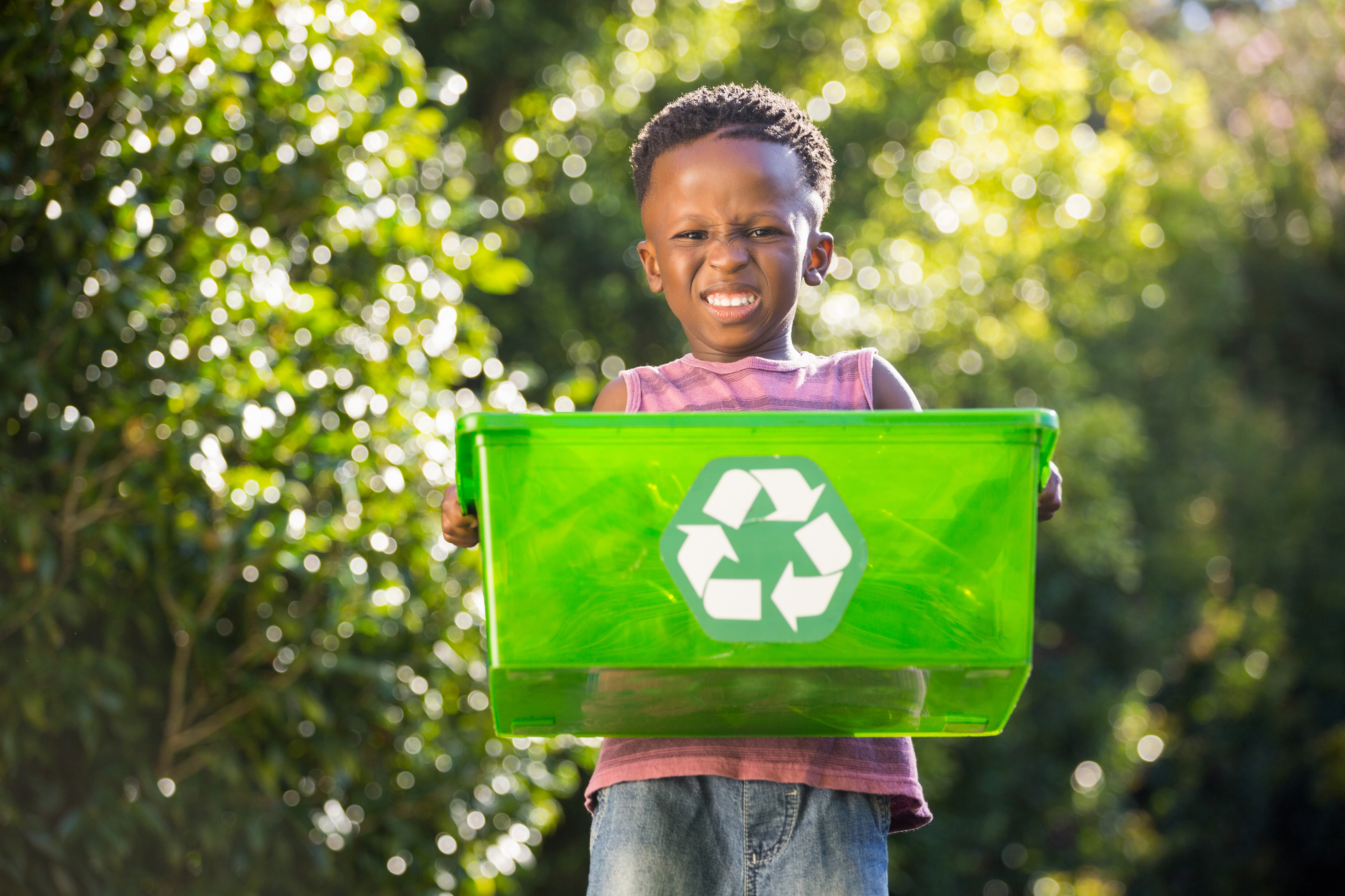 Boy carrying a recycle trash