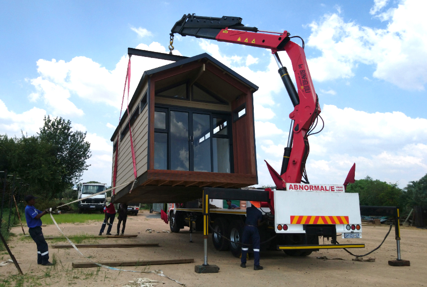 Timber-frame homes and isolation units could be mass produced in panel form and speedily erected by an existing construction workforce. Credit: Eco Log Homes